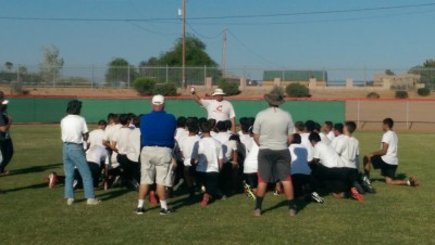Combs' HC Jesse Hart addressing his team after spring practice.