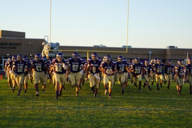 Nate NeVille (22) and the rest of the Bulldogs take the field before Friday's kickoff.