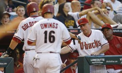 Arizona Diamondbacks' Paul Goldschmidt (44) and Chris Owings are greeted by Arizona Diamondbacks manager Chip Hale (3) after they scored on a triple by Mark Trumbo during the first inning of their MLB game  against he Colorado Rockies Tuesday, April 28, 2015 in Phoenix, Ariz.