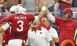 Arizona Cardinals quarterback Carson Palmer (3) and head coach Bruce Arians celebrate late in the Cardinlals 31-19 win over the New Orleans Saints in their NFL game Sunday, Sept. 13, 2015 in Glendale, Ariz.