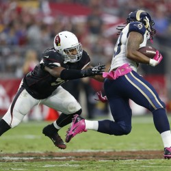 Arizona Cardinals LB Kevin Minter tries to tackle St. Louis Rams RB Todd Gurley during the second quarter at University of Phoenix Stadium in Glendale October 4, 2015.