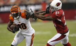 Cardinals cornerback Patrick Peterson tackles Bengals #18 wide receiver A.J. Green during the second quarter of a NFL game at University of Phoenix Stadium on August 24, 2014.