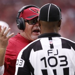 Arizona Cardinals Bruce Arians talks to an offical against the New Orleans Saints during the first half on Sep. 13, 2015 in Glendale, AZ.