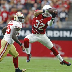 Arizona Cardinals free safety Tyrann Mathieu (32) picks off a pass intended for San Francisco 49ers tight end Vernon Davis (85) in the 2nd quarter of their NFL Sunday, Sept. 27, 2015 in Glendale, Ariz.