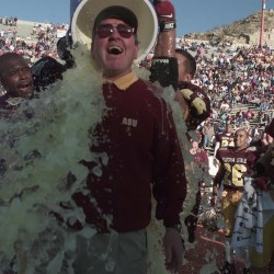 ASU football coach Bruce Snyder is dunked with ice water after the Sun Devils beat the Iowa Hawkeyes 17-7 in the Sun Bowl on Dec. 31, 1997, in El Paso, Texas. (Arizona Republic photo by Rob Schumacher) ELECTRONIC CAMERA IMAGE -- NO NEGS