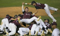 Hamilton's Brayden Merritt (1) rides the top of a pile of his teammates celebrating the Division I State Championship win over Mountain Ridge at Tempe Diablo Stadium on May 17, 2016 in Tempe, Ariz.