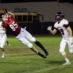 Photo by Noah Rodriguez '17 | Matthew Kempton '17 makes a leaping catch Sept. 4 against Liberty. Brophy defeated Liberty High School 31-10.