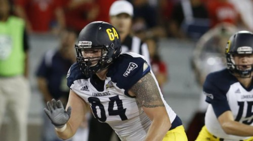 Northern Arizona offensive lineman Jacob Julian (64) during the second half of an NCAA college football game against Arizona, Saturday, Sept. 19, 2015, in Tucson, Ariz. (AP Photo/Rick Scuteri)