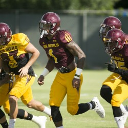 ASU receiver N'keal Harry (center) sprints to a drill during ASU football practice at the ASU practice facility in Tempe on Tuesday, August 23, 2016.