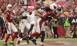 Arizona Cardinals Larry Fitzgerald catches a 4-yard touchdown pass from Carson Palmer against the Tampa Bay Buccaneers in the first half on Sep. 18, 2016 in Glendale, AZ.