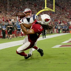 Rob Schumacher/azcentral sports Cardinals receiver Larry Fitzgerald catches a pass for his 100th career touchdown reception as Patriots cornerback Logan Ryan defends during the fourth quarter of Sunday?s game in Glendale. Arizona Cardinals wide receiver Larry Fitzgerald (11) catches the ball for a touchdown as New England Patriots cornerback Logan Ryan (26) defends during the fourth quarter of an NFL football game between the Arizona Cardinals and the New England Patriots in Glendale, Az., on Sunday, Sept. 11, 2016.  This was Fitzgerald's 100th career touchdown.