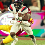 Tate, Wildcats fall to USC